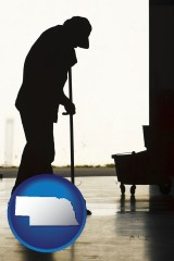 nebraska map icon and a janitor silhouette