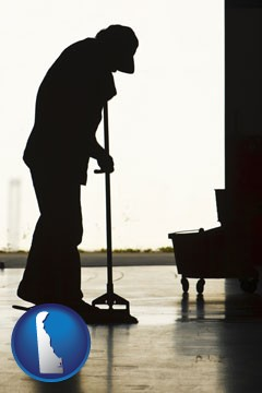 a janitor silhouette - with Delaware icon