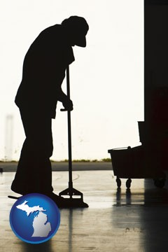 a janitor silhouette - with Michigan icon
